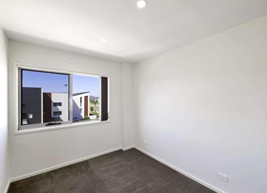 Một phòng ngủ của căn hộ ở Harrison Úc