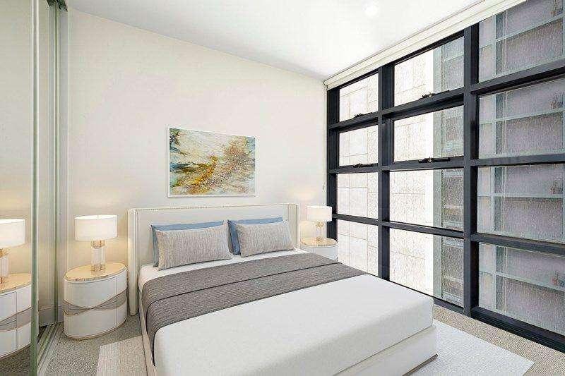 Phòng ngủ đầy đủ ánh sáng với cửa sổ kính lớn